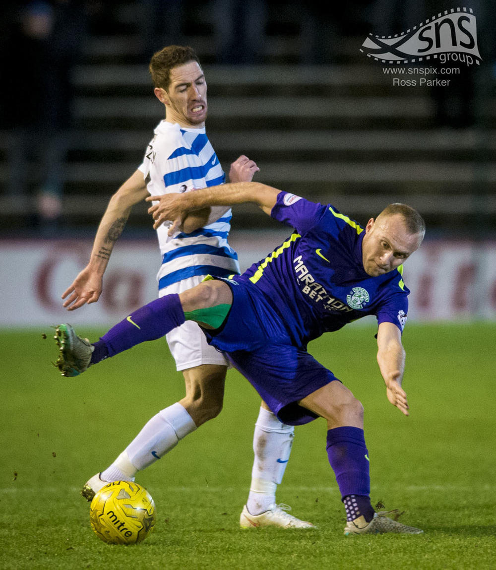 Dylan McGeouch of Hibs holds off Stefan McCluskey of Morton at Cappielow.
