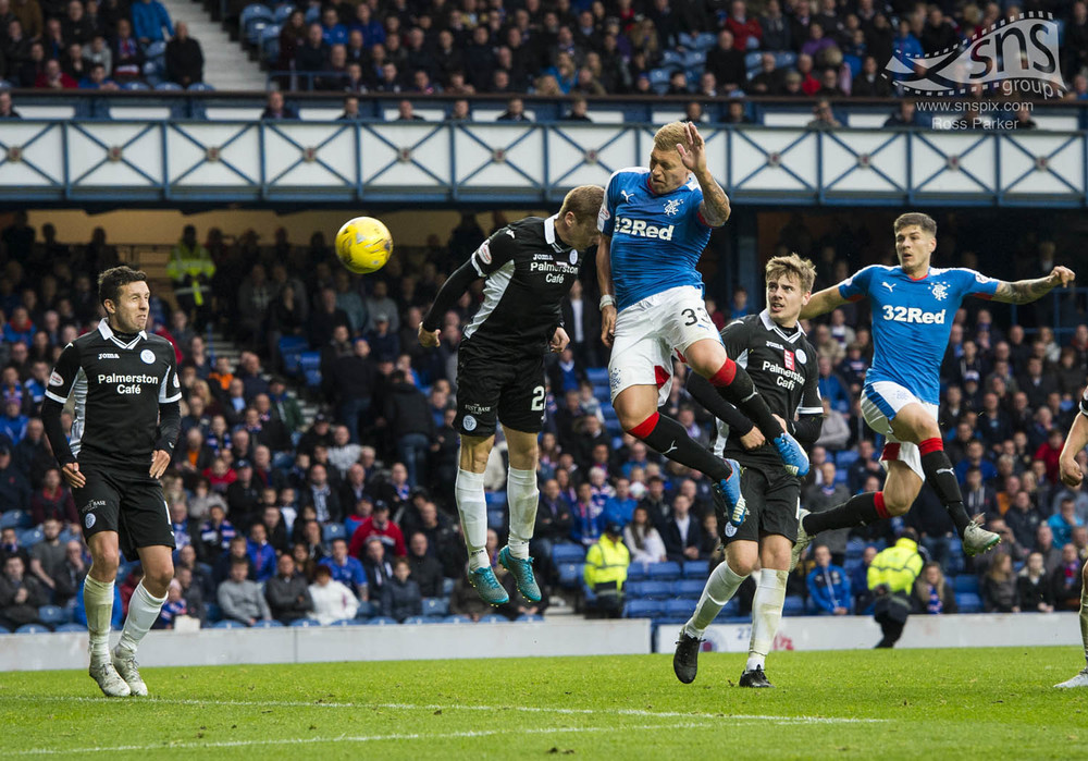 Martyn Waghorn of Rangers heads home a 90th minute winner against Queen of the South to send Ibrox into raptures.