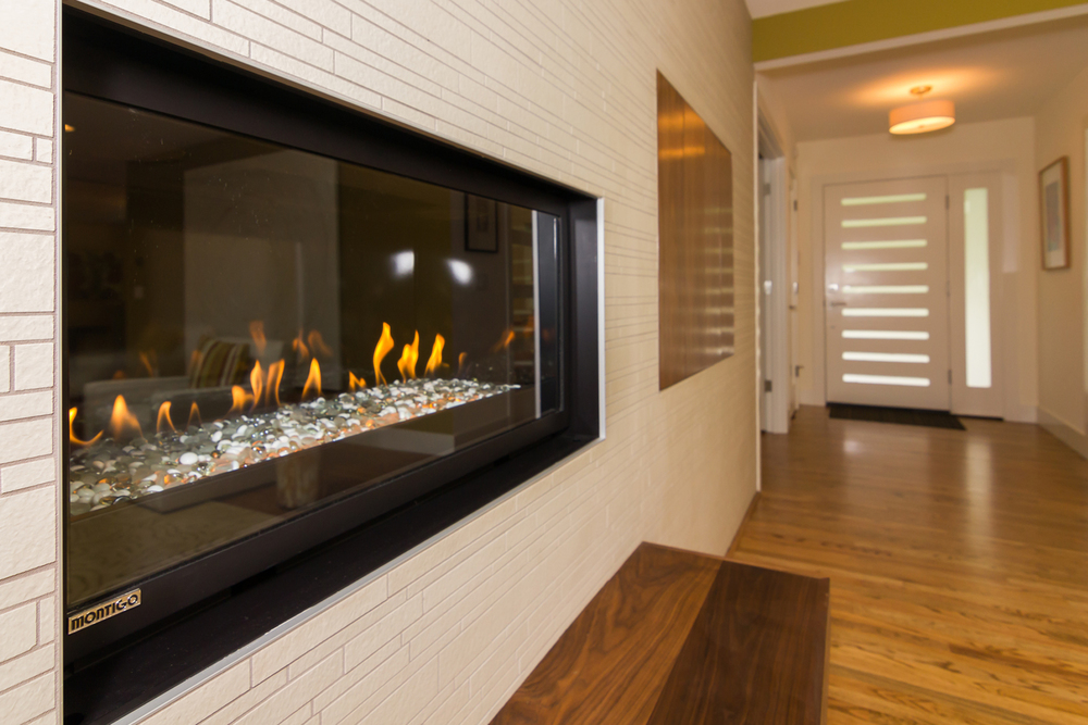 Gas fireplace detail with custom walnut bench.