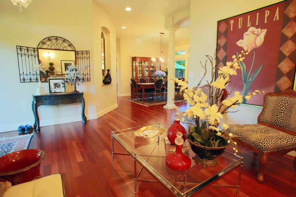 Gorgeous cherry wood floors in formal living room, dining, and office