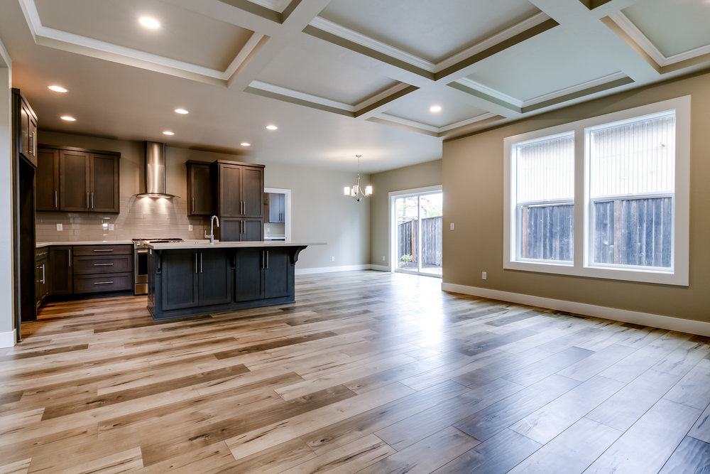 The coffered ceiling in the great room, wide molding and beautiful hardwood floors bring natural elegance to this open space.
