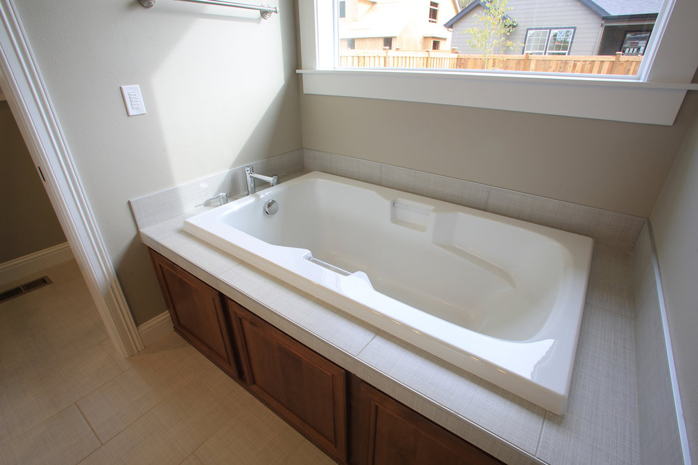 Please note that the colors and materials in the master bathroom will vary from what is in this photo.