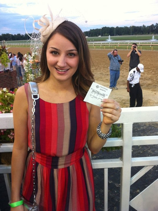 My BFF Michelle with a winning across-the-board ticket at the 2012 Virginia Derby... on my tip.