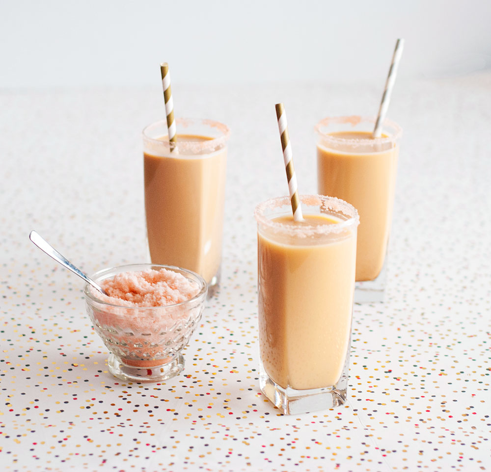 Espresso rum fizz with a pink aromatic bitters sugar rim | freckleandfair.com