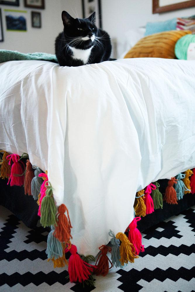DIY boho yarn tassel duvet blanket | www.freckleandfair.com