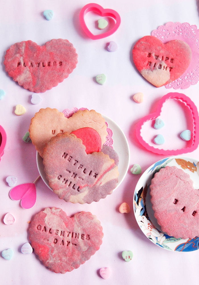 Marbled conversation heart sugar cookies with pop culture phrases for Valentine's Day | www.freckleandfair.com