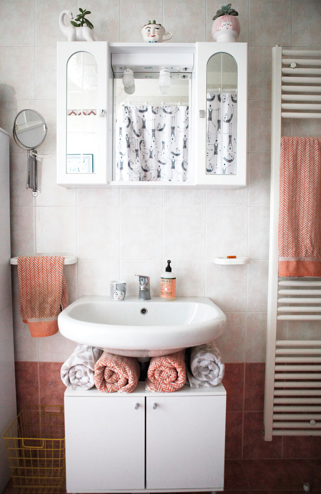 Whimsical pink bathroom with Scandinavian details | www.freckleandfair.com