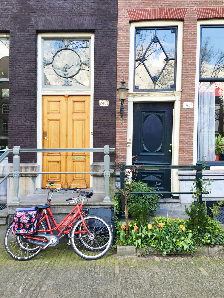 Bicycles and row houses in Amsterdam | freckleandfair.com
