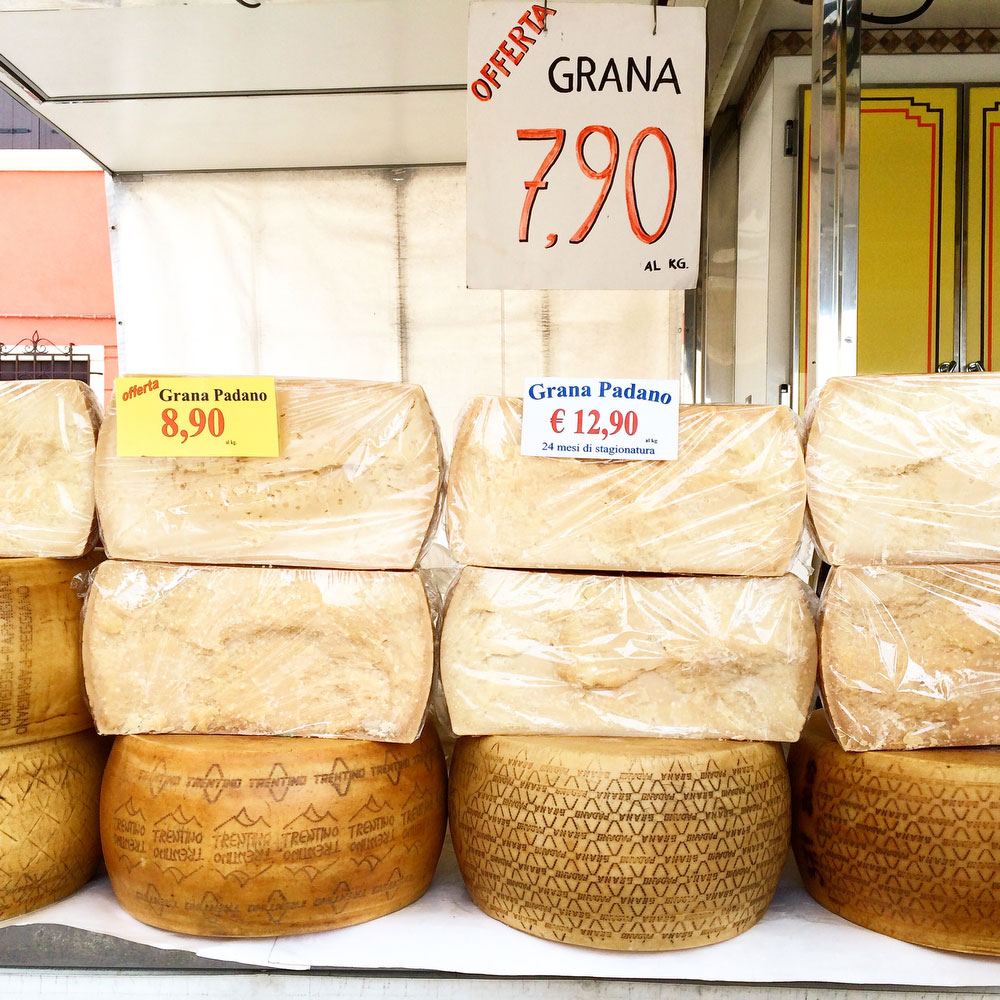 Giant wheels of cheese at the Camisano market