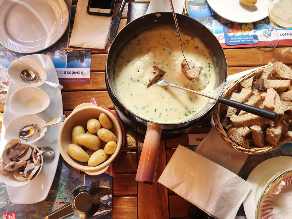 Eating fondue — A guide to the Bernese Alps of Switzerland | freckleandfair.com