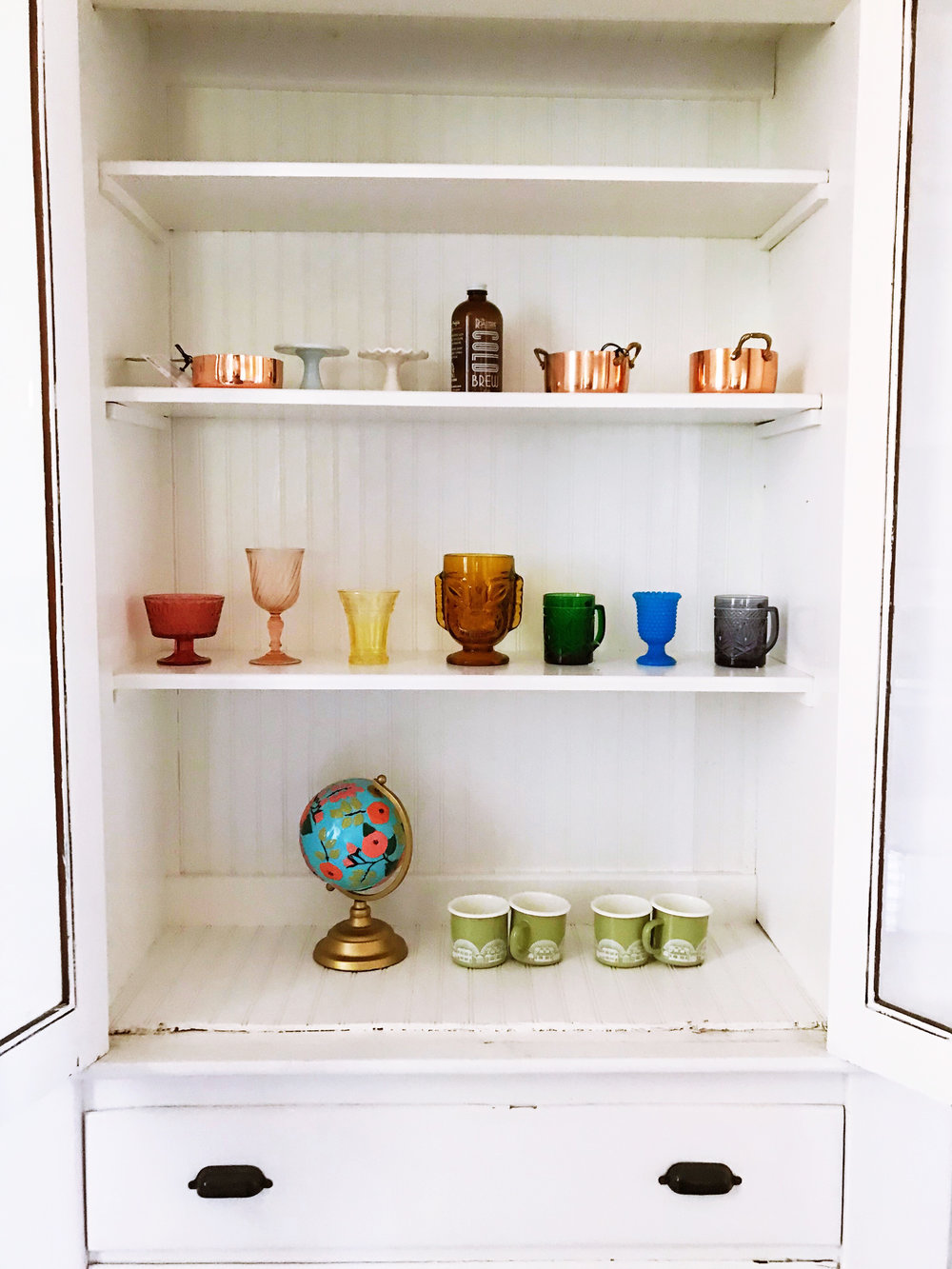 Built-in china cabinet with rainbow depression glass | Freckle & fair