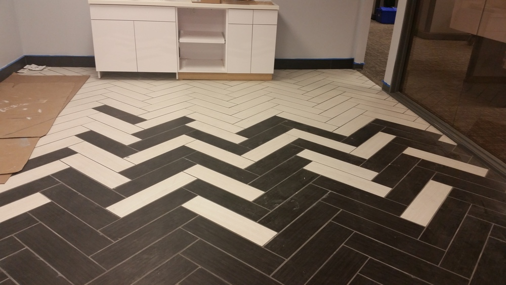 DalTile wood grain tile installed in a herringbone pattern.