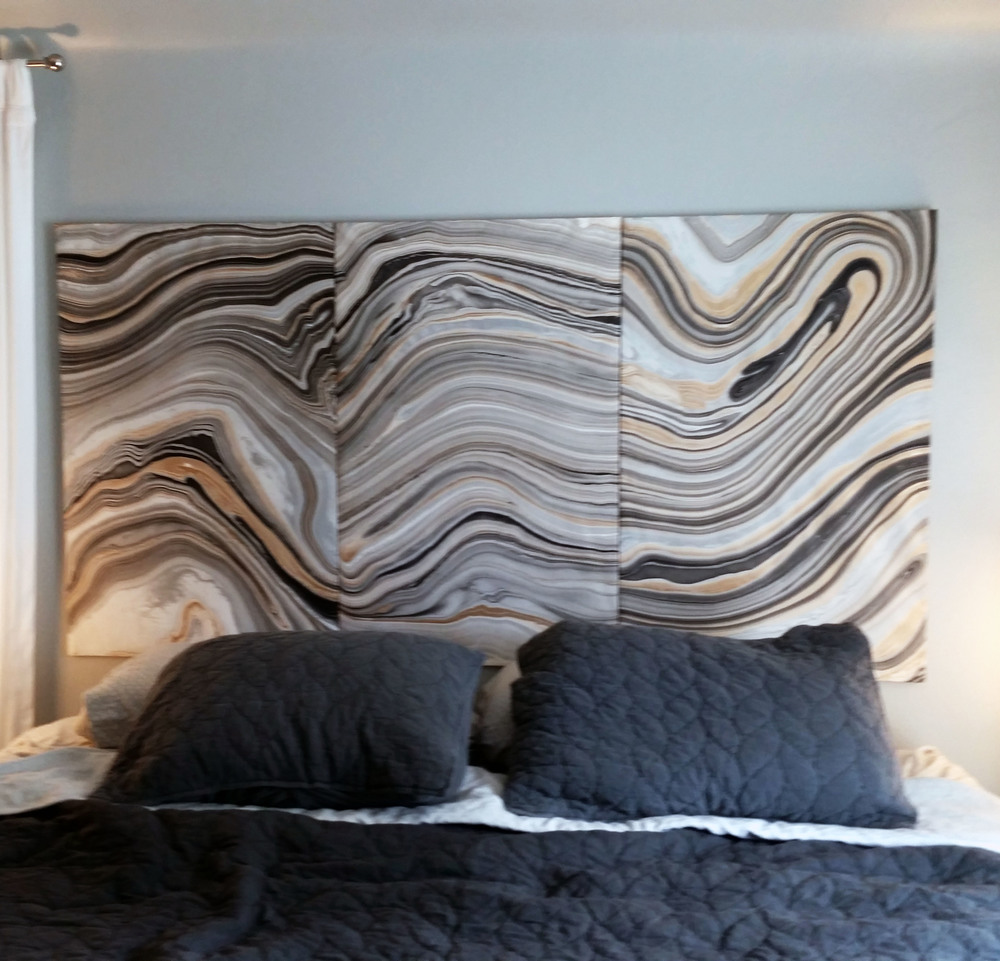This is the marbled headboard from the previous post. I decoupaged 3 wood panels and hung them as a triptych behind the bed. I really love how it turned out. The movement of the marbling creates great contrast between the mostly monochromatic elements in the bedroom. I am definitely going to style the bed with more throw pillows and a throw blanket to give it more layering. Perhaps touches of gold...