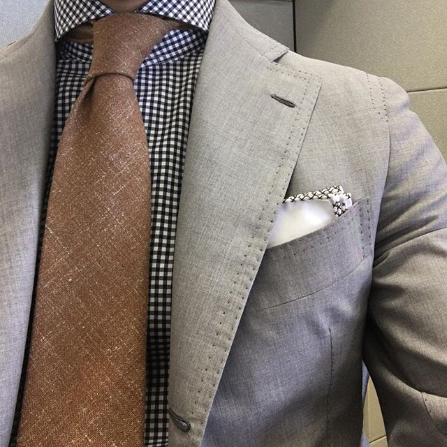 Cashmere, silk, and linen ninefold tie paired with a light grey suit.