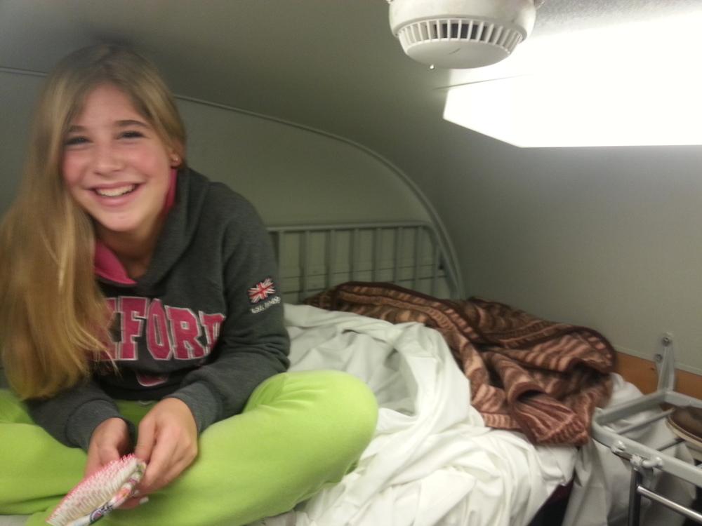 Having fun on the top bunk