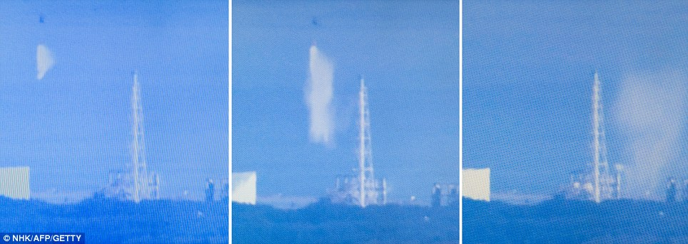 11a helicopter dumps water onto the number three reactor.jpg