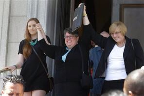 Plaintiffs in the federal suit over Virginia's ban on gay marriage, Emily Schall-Townley, left, Carol Schall, center, and Mary Townley,