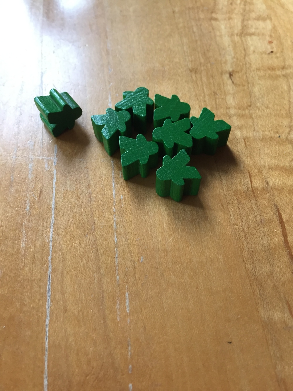 "These are ""meeple"" - you use them to play Carcasonne.  Specifically, these were my green meeple."