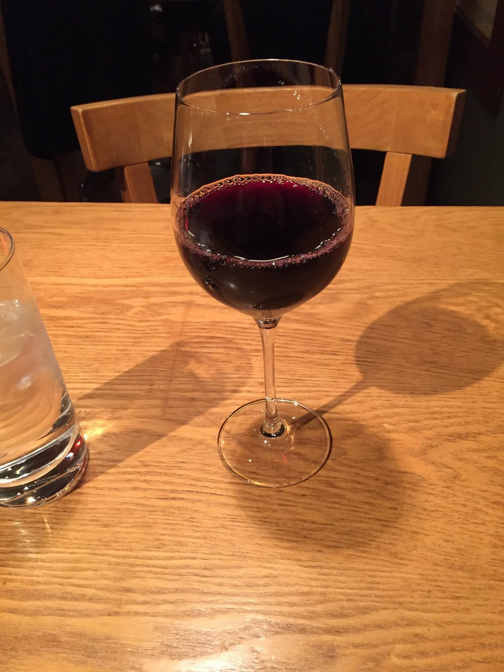 A delightful glass of shiraz.