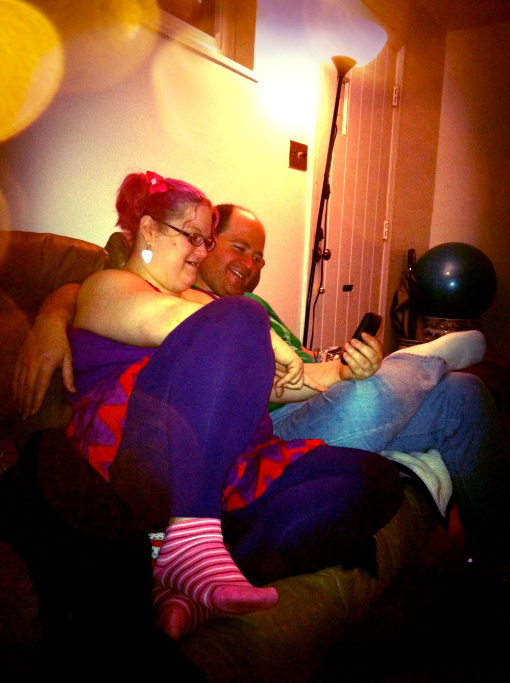 Andrea and I sharing a cuddle, and laughing together, back in 2010