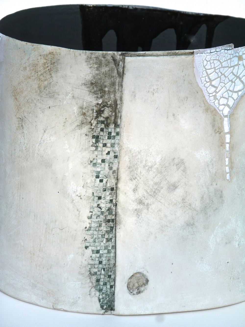 Stoneware Vessel: H. 23cm W.19cm. Close up: layers of slip, glazes, oxides, stain, Impressed textures and transfers.