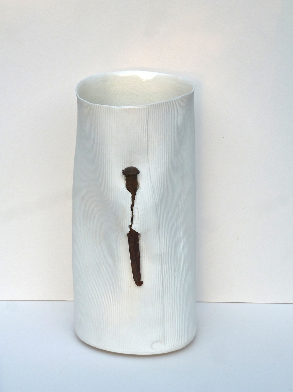 Nail Vessel: H. 25cm. Porcelain paper clay, impressed with corrugations and a transparent, shiny crackle glazed interior.