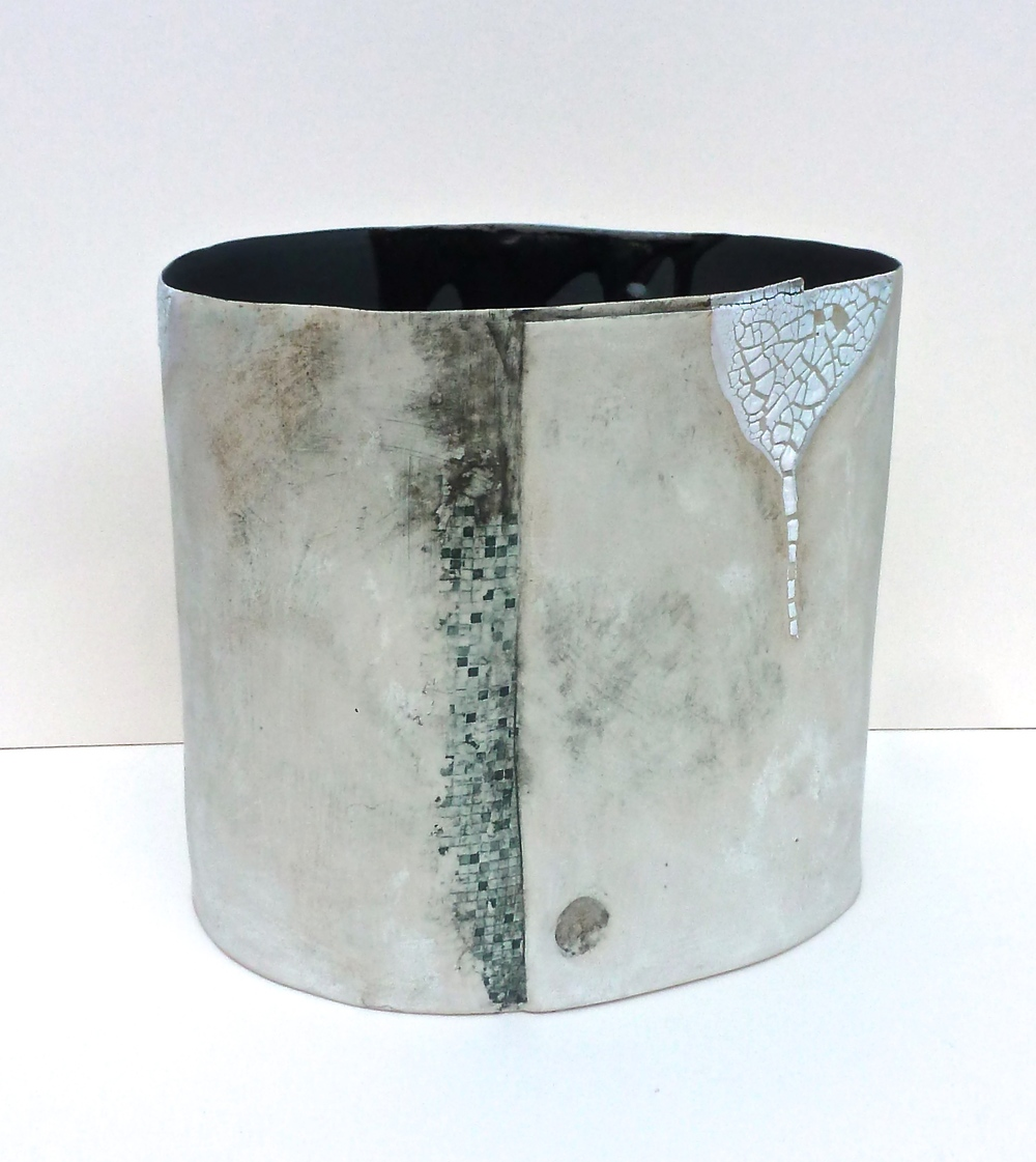 Stoneware vessel: H. 19cm W.23cm. Porcelain slip, glazes, oxides, stains, impressed textures and transfers.