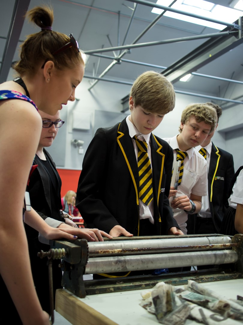 Students from The Studio School in Liverpool working out how to use the STIXX rolling machine before a load of local primary school children descend on their STEAM CO. Day