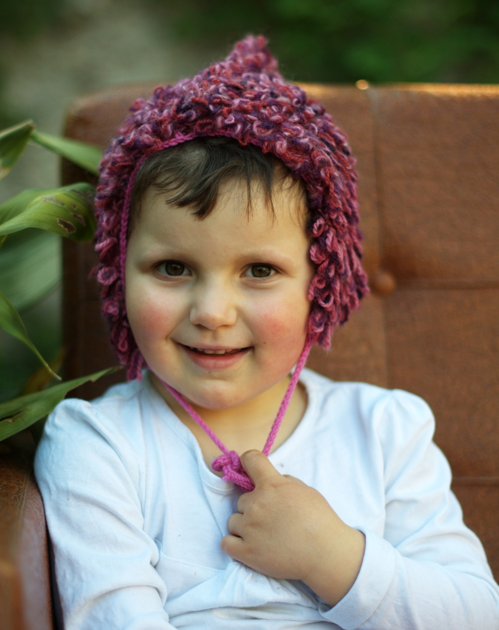Loopy childs bonnet knitting pattern