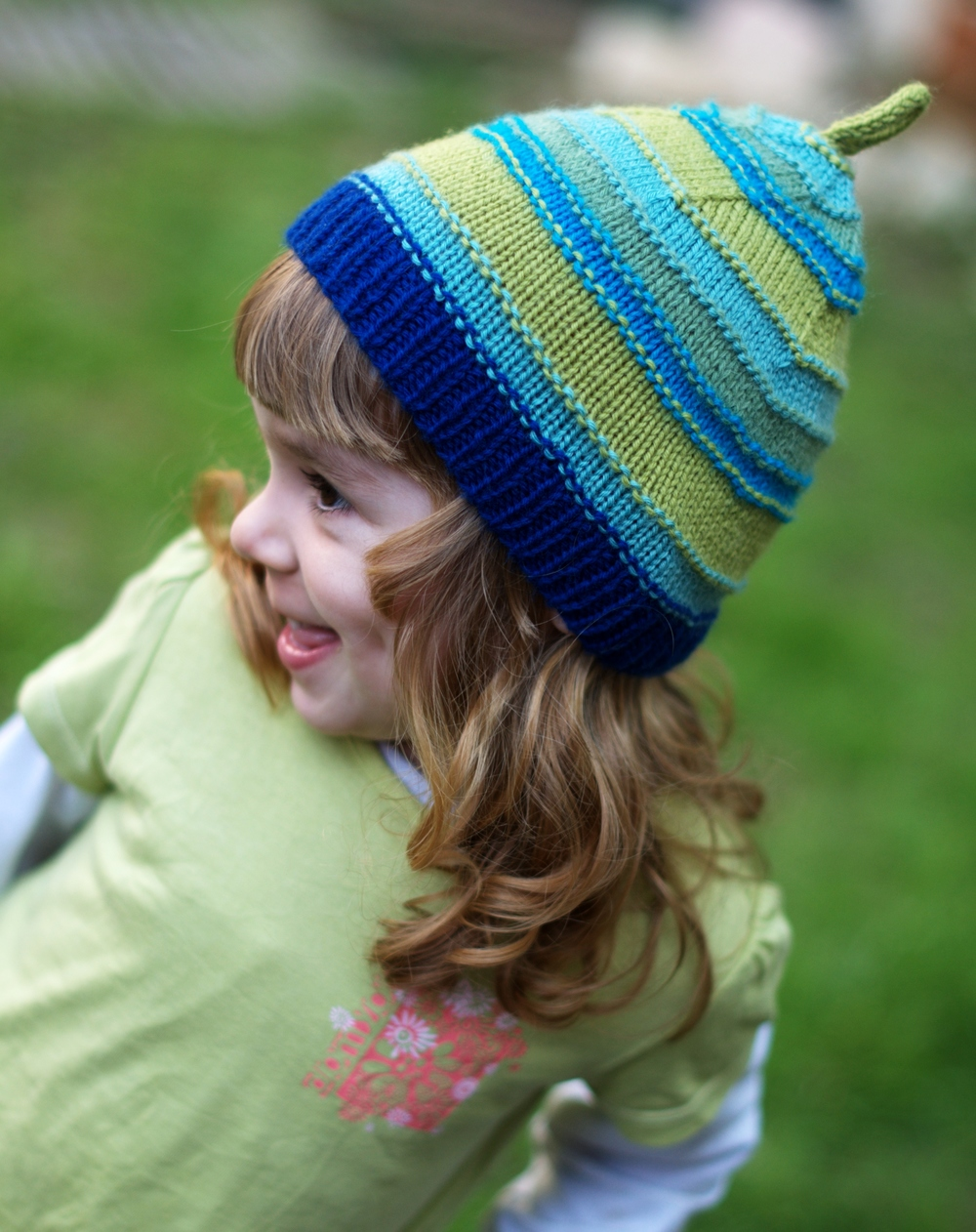 Trullo childs striped pixie hat knitting pattern