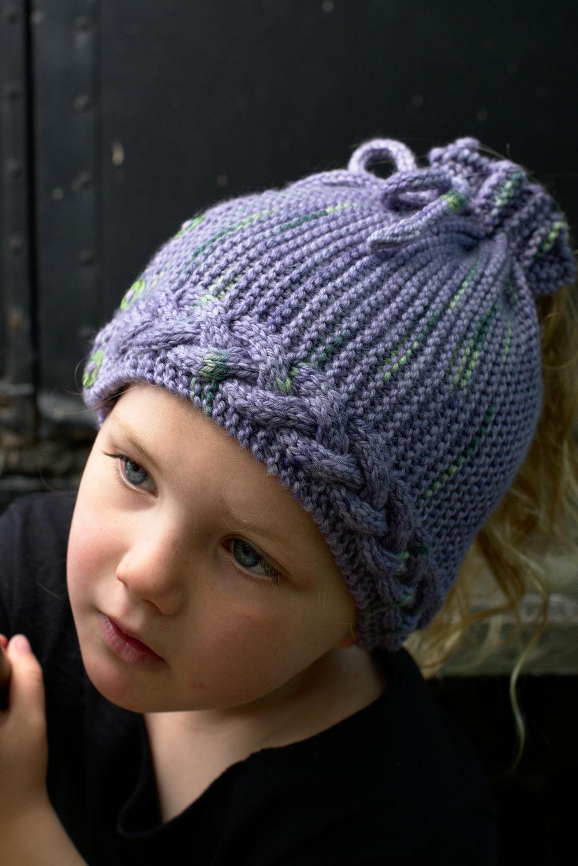 Arcus sideways knit ponytail Hat knitting pattern for Craftsy Cloudborn Fibers yarn