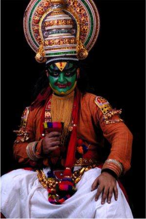 Kathakali is a 17th century Indian Dance Theater that uses dance, music, and elaborate costumes and make up and a hand gestural language of 'Mudras' to tell dramatic and powerful stories from the Mahabharata.