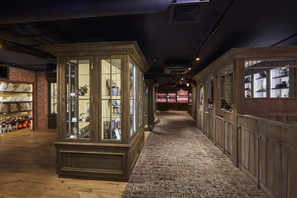 Propability, Noble Collection, immersive retail, cabinets, stone floor1.jpg