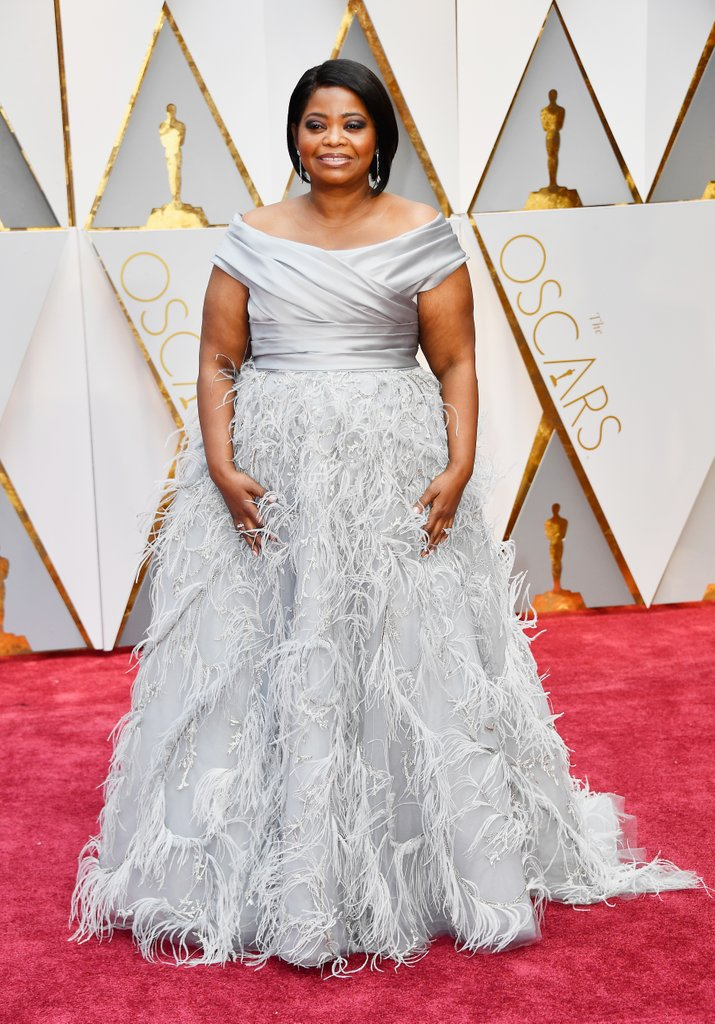 Octavia Spencer is also giving us elegant floating on a dream wearing a Marchesa dress, Stuart Weitzman shoes, and Forevermark jewels.