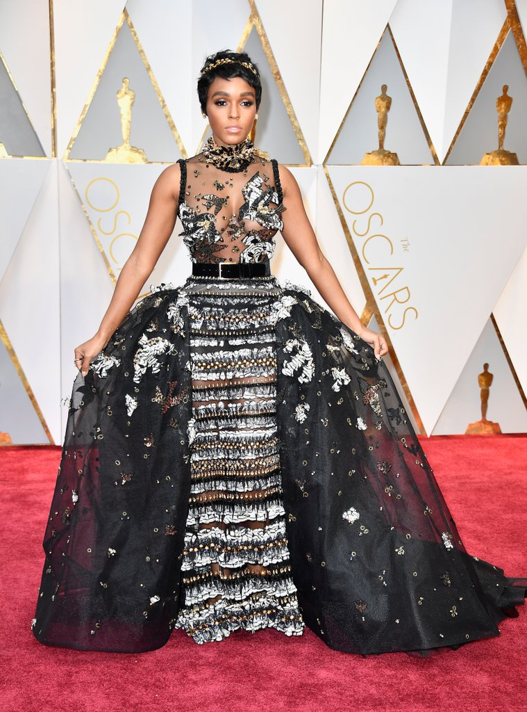 Chanelling an Audrey Hepburn-esque princess, Janelle Monáe shines in Elie Saab Haute Couture, Jennifer Behr crown, Forevermark jewels, and Brian Atwood shoes.