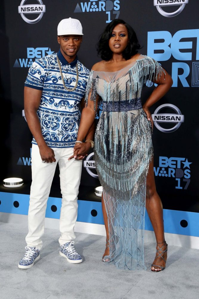 Black Love drapped in blue, Remy Ma and husband Papoose.