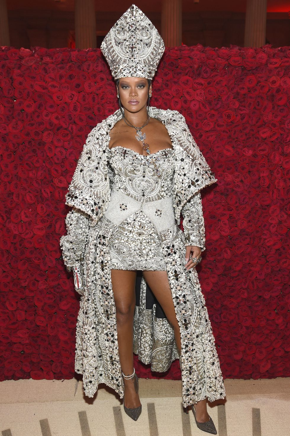 Rihanna in custom Maison Margiela by John Galliano, Christian Louboutin shoes, Maria Tash jewelry, Cartier jewelry, and a custom Judith Leiber Couture clutch.