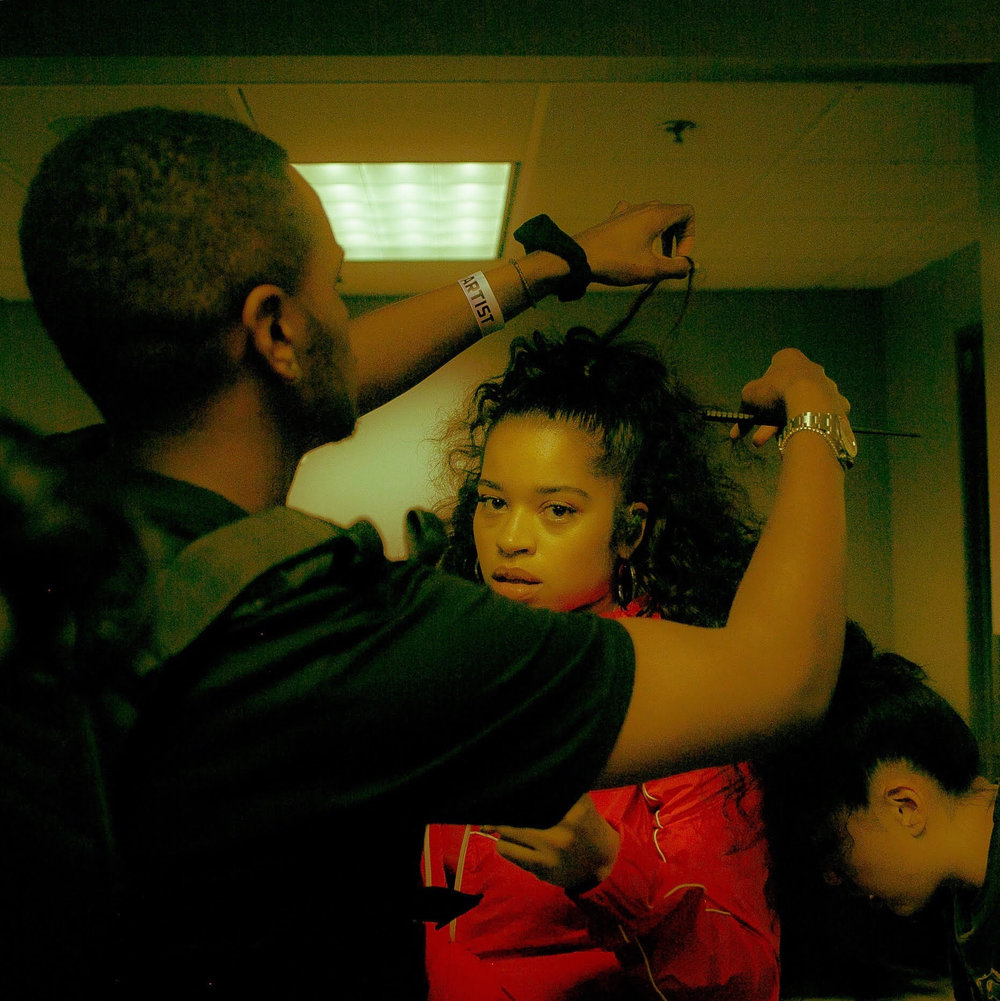 Kahh Spence styling Ella Mai's hair. She is wearing  Indique's PURE Curly