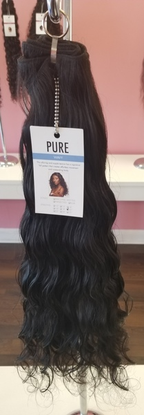 Pure Wavy  with  Design Essentials Almond and Avocado Mousse  applied to dry hair.