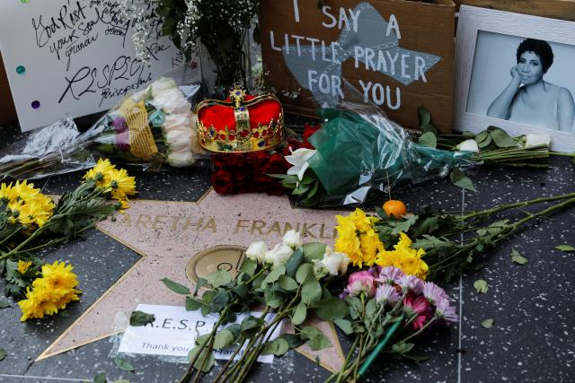 Well-wishers lay flowers, notes, and other memorabilia at her Hollywood Walk of Fame Star in Hollywood, Los Angeles, California (Picture Source: Reuters).