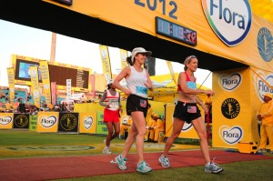Karen crossing the finish line with fellow HomeAway employee, Karen Hatley.