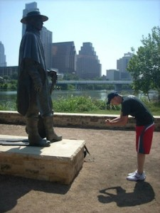 Paying respect to one of his music idols, Stevie Ray Vaughn, on a trip to Austin.