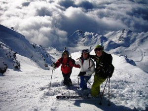 With her brother and sister skiing the Alps.