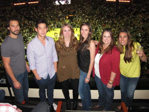 Team HomeAway enjoying their victory prize, a suite at a Texas Spurs game.