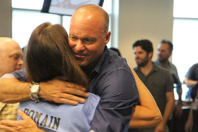 "HomeAway CEO Brian Sharples thanks Facilities Manager Ronda ""Ronnie"" Stahl for all of her efforts to complete the new office space."