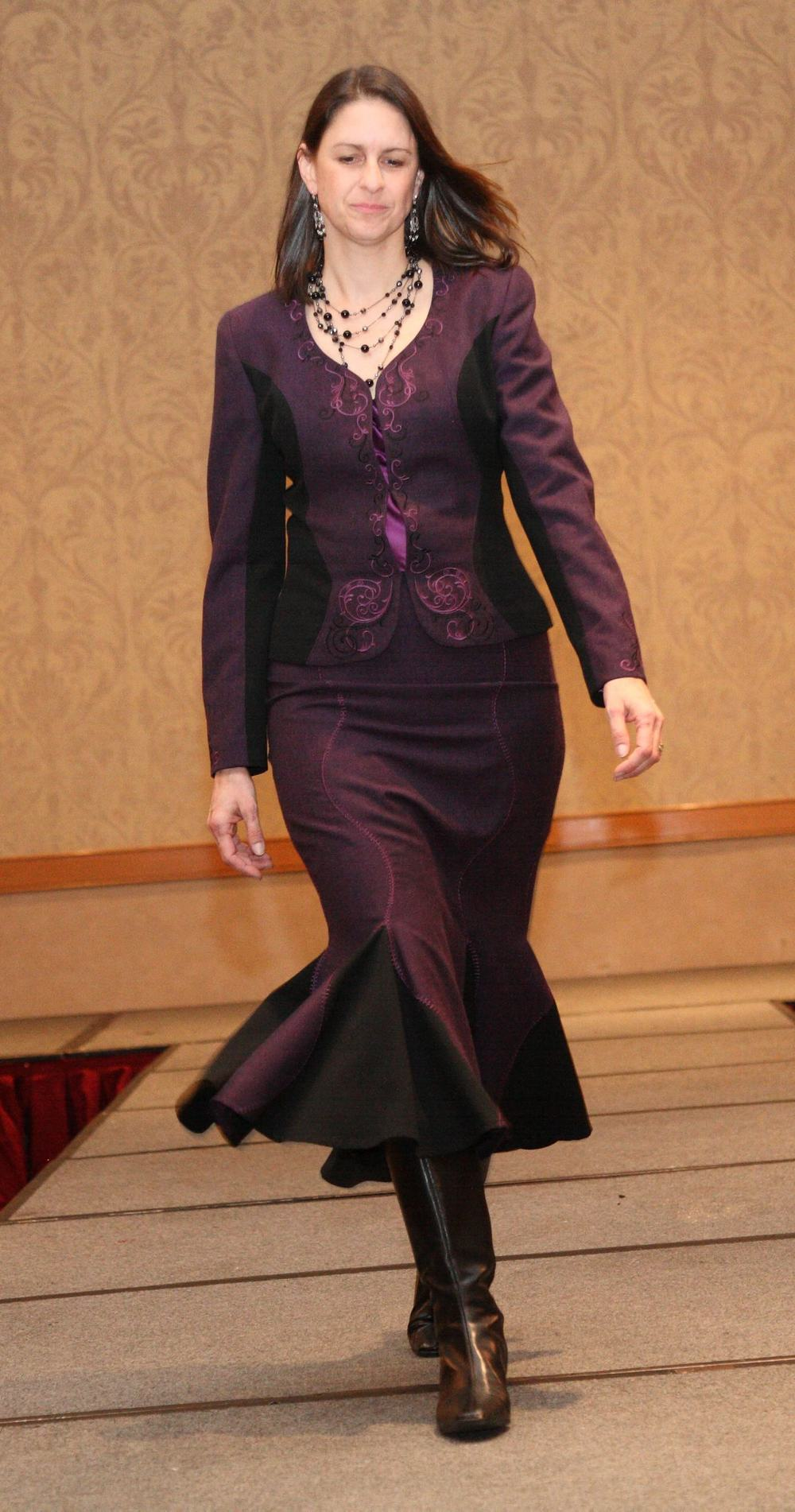Juliette struts her stuff on the runway wearing a suit she designed in the 2010 Threads Magazine Challenge.