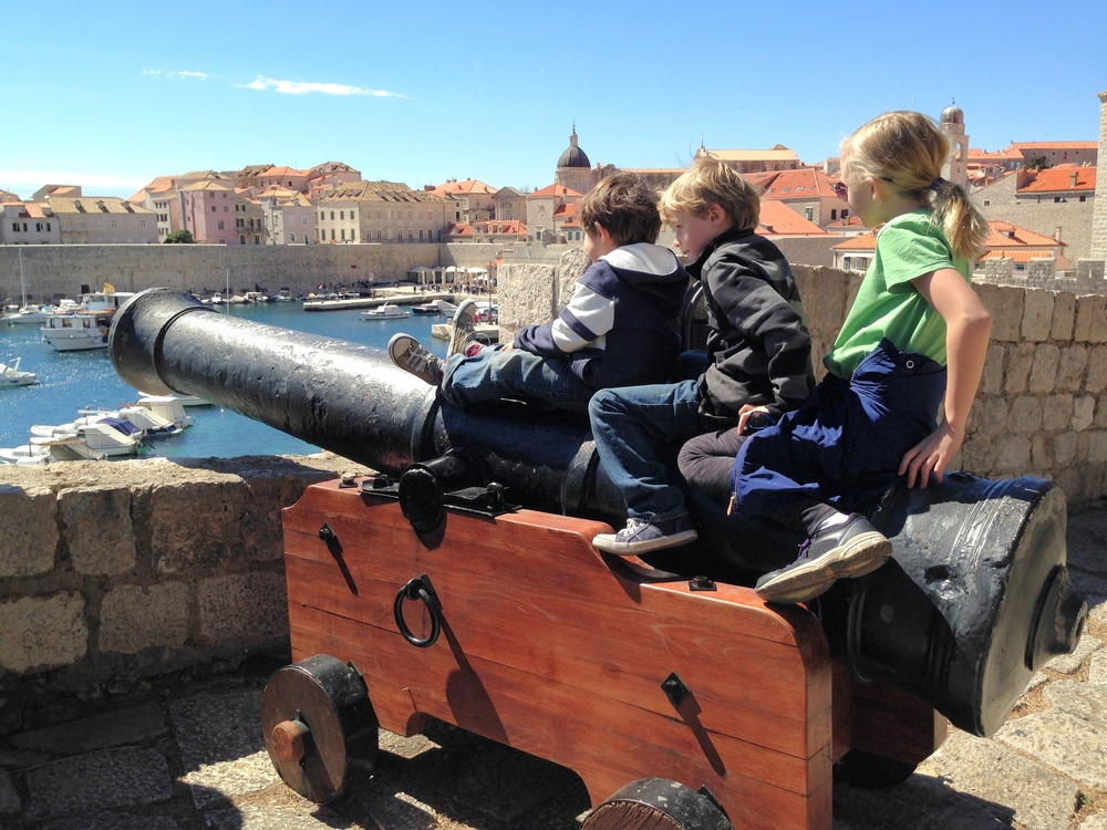 Tatum with her brothers on a canon in a fortress in Dubrovnik, Croatia.