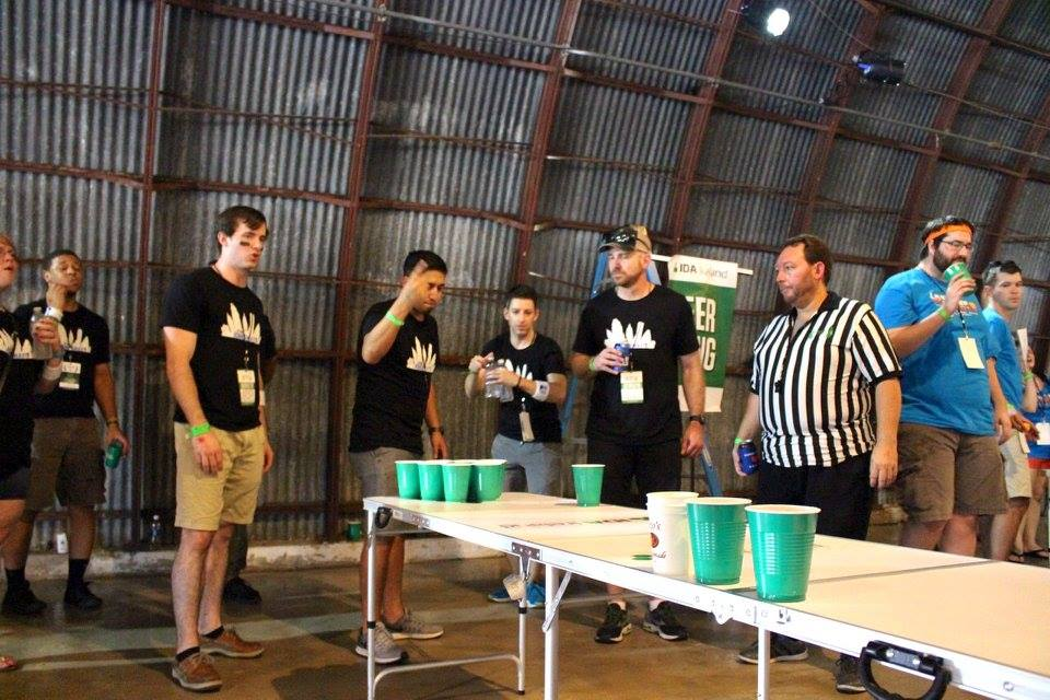 Team HomeAway warming up for round two of beer pong.