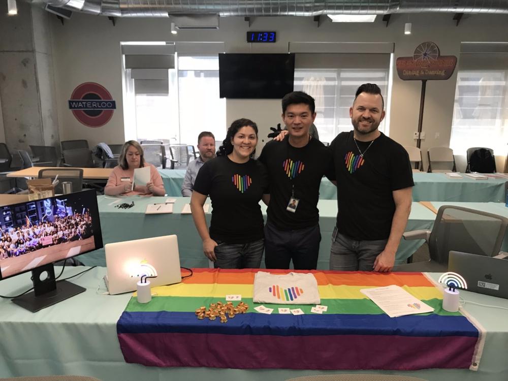 Juliana Leon, Rustan Valino, and Layne Box tabling for HomeAway Pride.