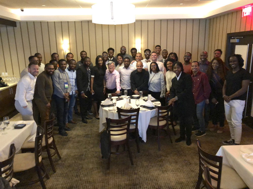 Team HomeAway at dinner in Pittsburgh with NSBE students.